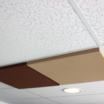 Have you thought of simply replacing your false ceiling slabs with acoustics slabs?